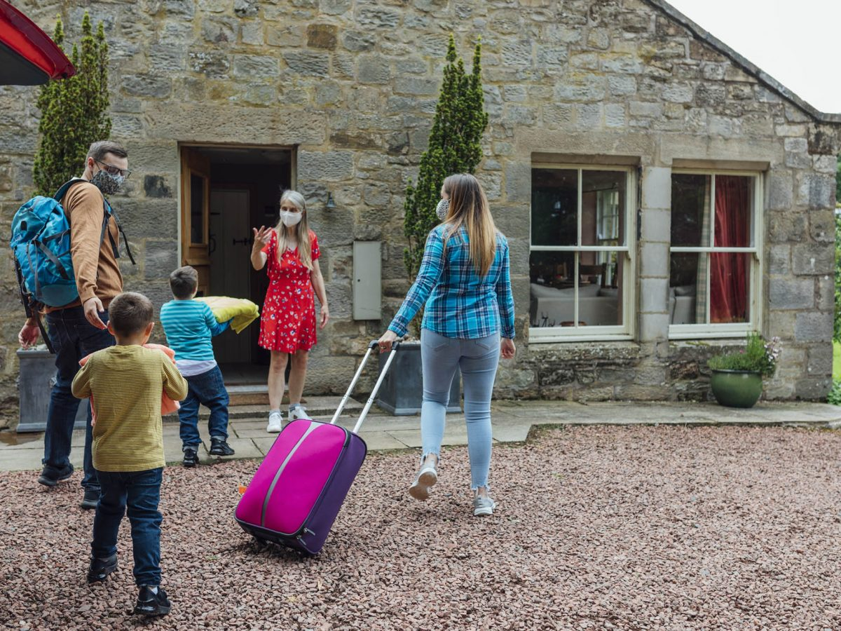 Family arriving to a holiday cottage